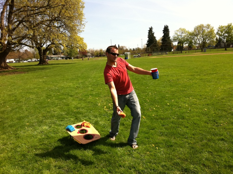 Jeff playing cornhole at Fernhill Park