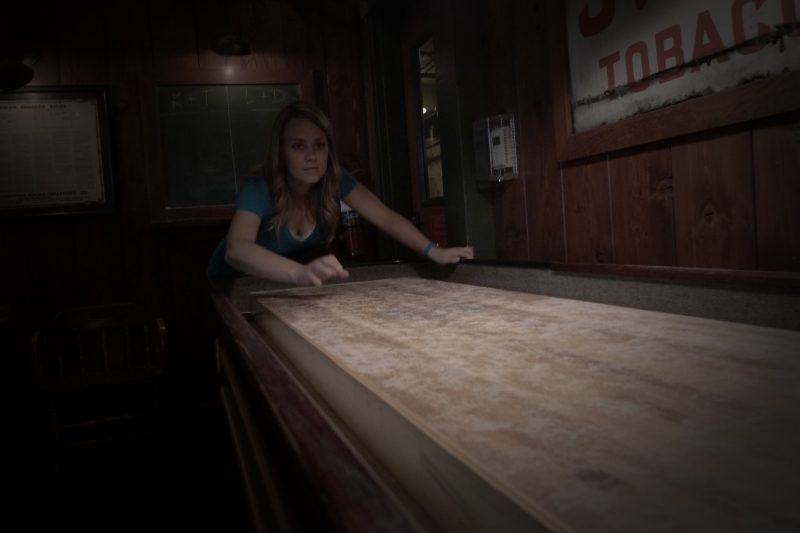 In the middle of a fierce game of shuffleboard at Lucky Staehly's Pool Hall at Edgefield
