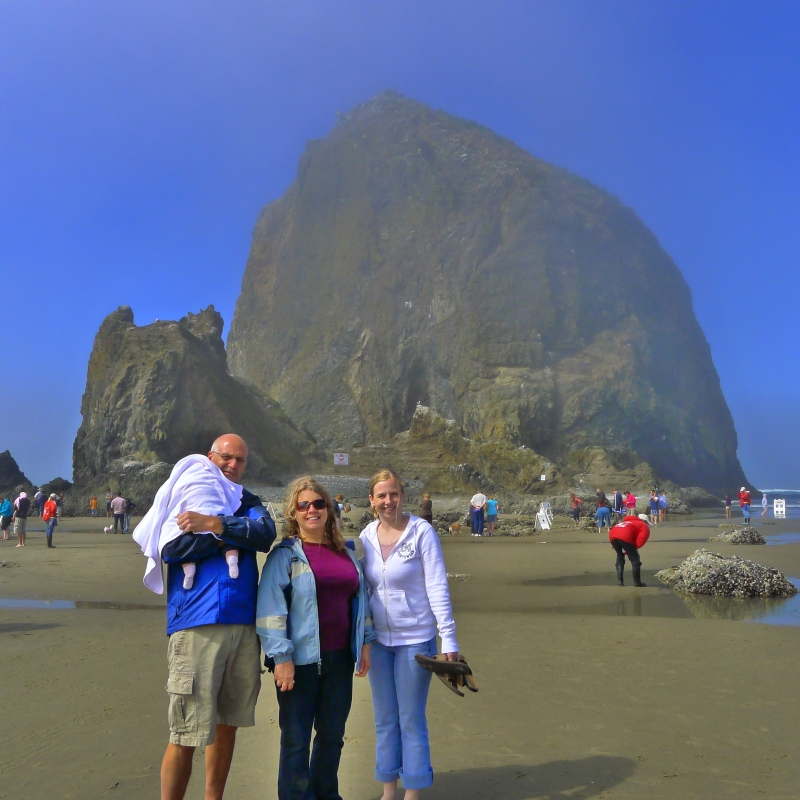 Dad, Mom, Macy and Lori in front of Haystack Rock at Cannon Beach