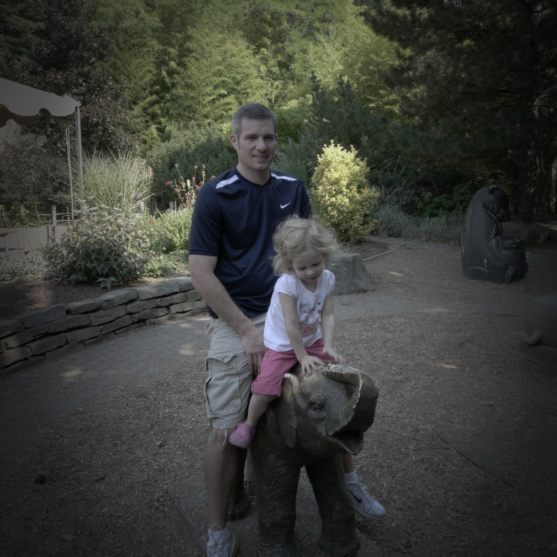 Ava talking to the elephant with her dad