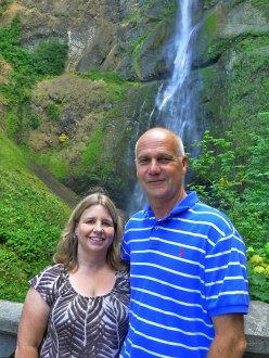Mom and Dad posing in front of the Multnomah Falls