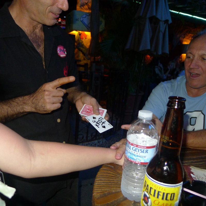 Totally mystified by a card magician at Cabo Wabo