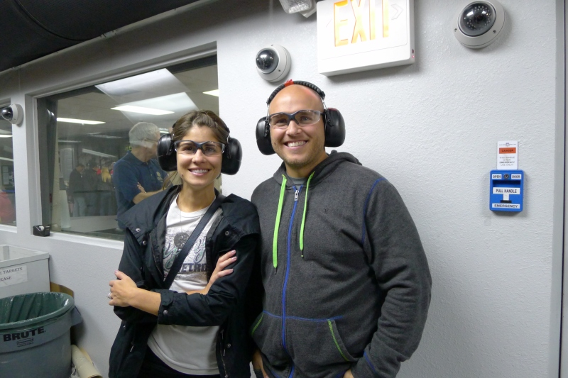 Rob and Amy watching Jeff in the shooting range