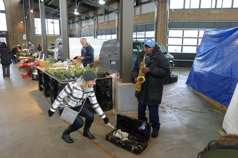 Tipping the saxophone man in Detroit's Eastern Market