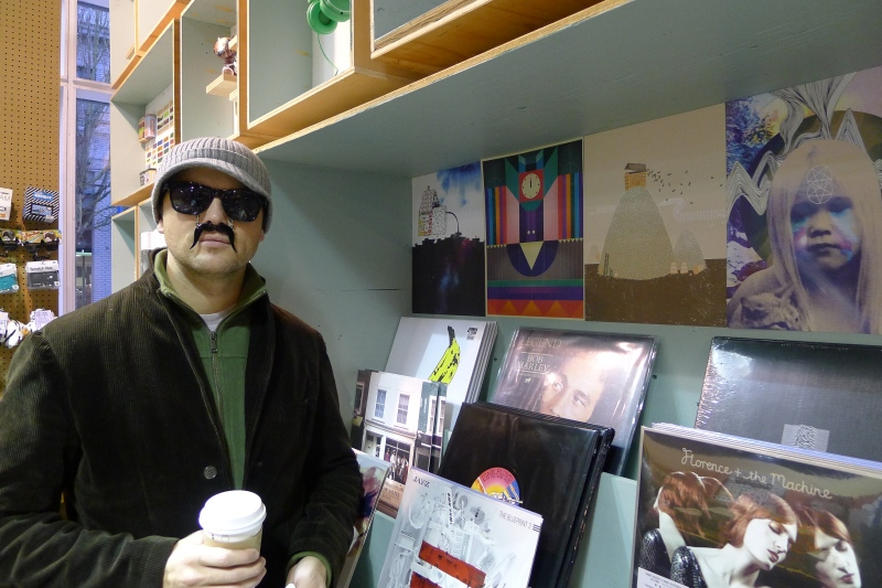 Jeff trying on a sunglasses/moustache combo at Urban Outfitters