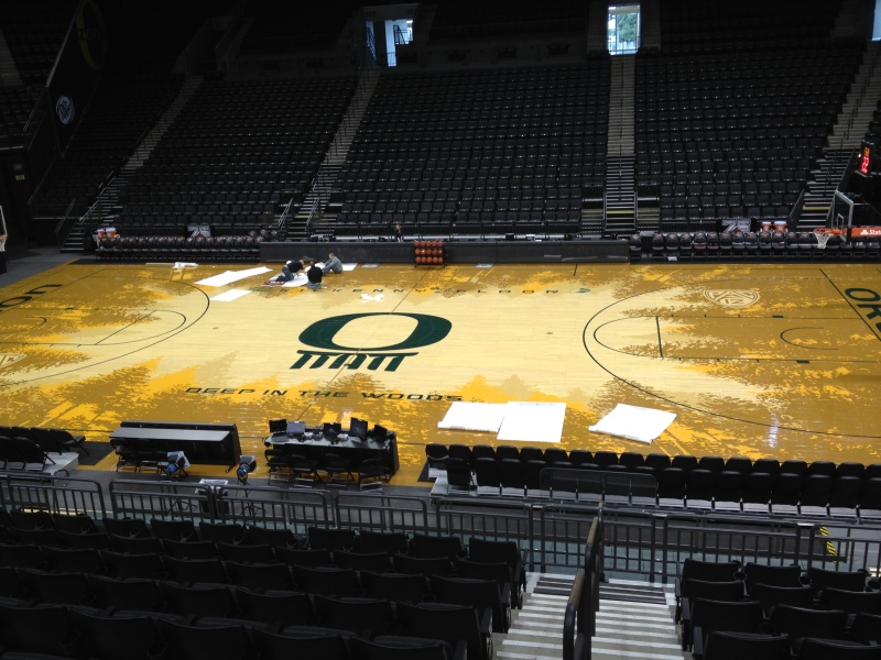 The forest-lined floor of Oregon's Matthew Knight Arena