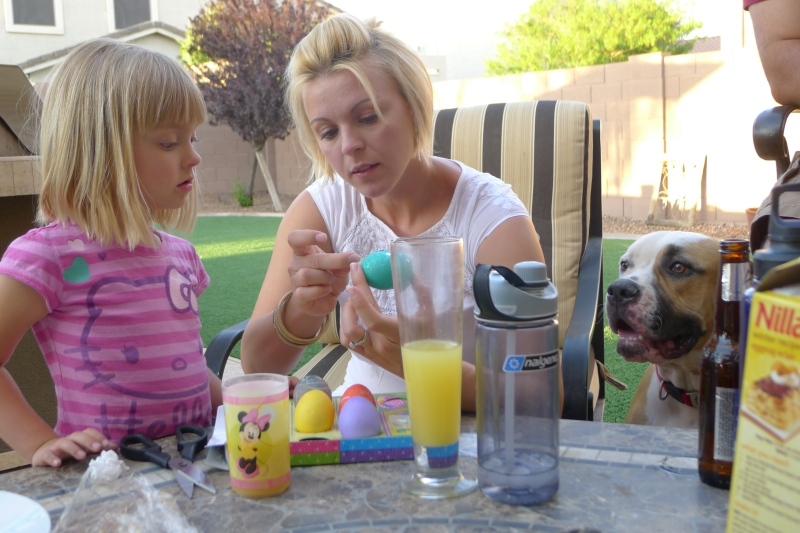 Maggie, Meleah and Bruno coloring Easter eggs