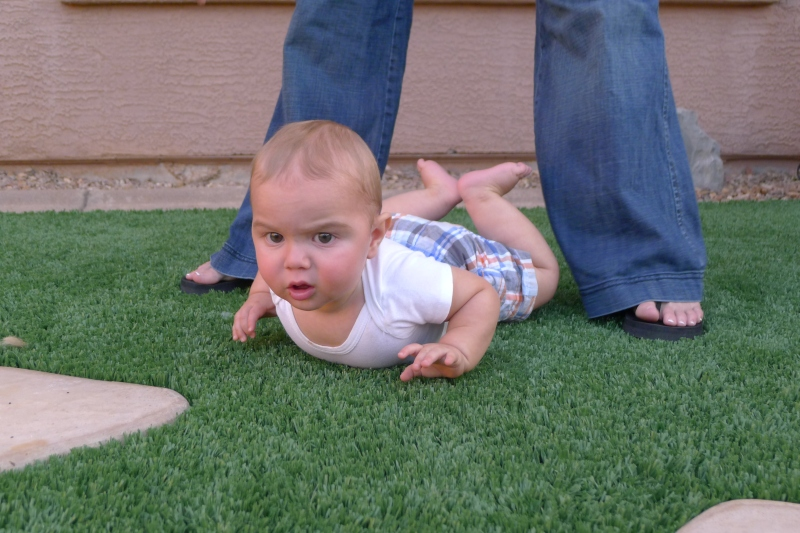 Little Easton scared to touch the turf in Phil and Meleah's backyard