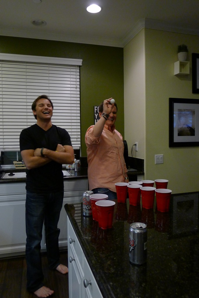 Jeff and Joey dominating at beer pong in Jason's kitchen