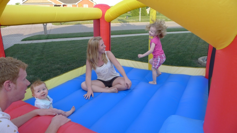 Bouncing with Aunt Shelly and Uncle Dave in Ava's inflatable house