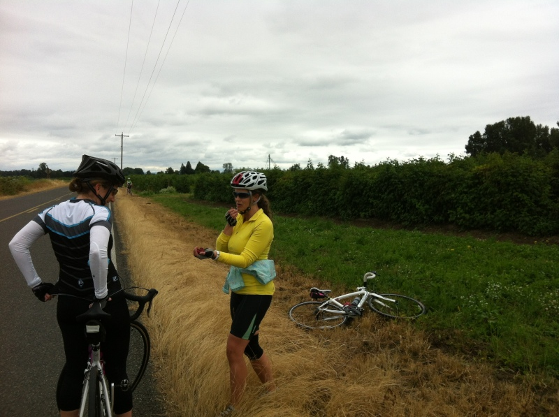 Jessica sharing some fresh-picked raspberries with Lindsey along our Sauvie Island ride