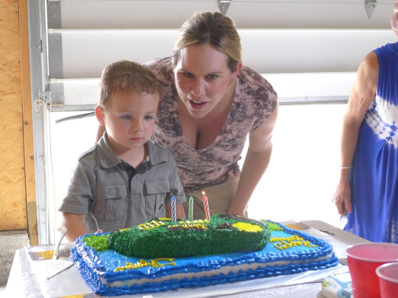 Thomas and mommy Vanessa getting ready to blow out some candles