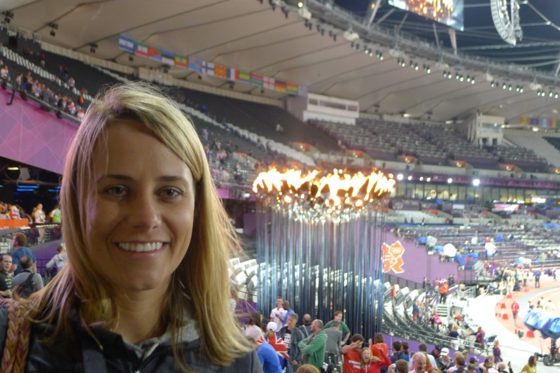 Posing in front of the Olympic flame after the Athletics event