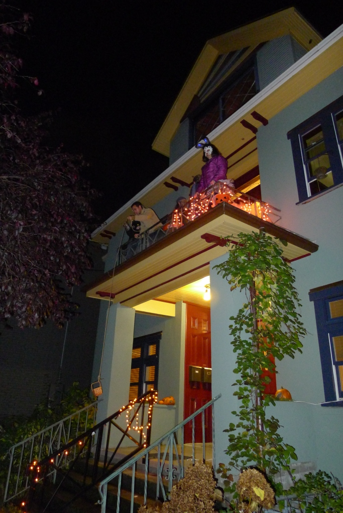 Lowering the Halloween candy basket from the front balcony