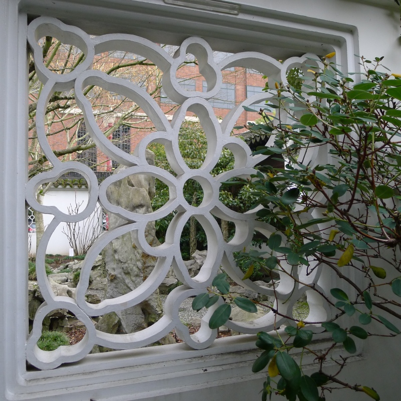 "Leak window, which reflects a pattern in nature and ""leaks"" a view into another space in the garden"
