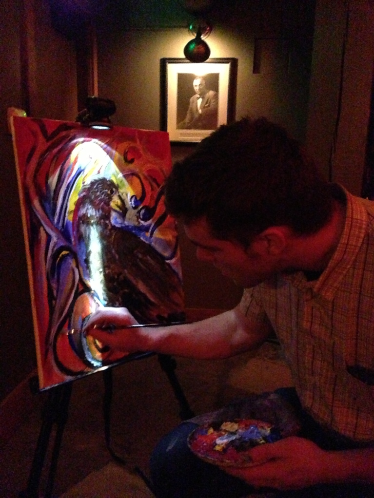 Kenneth Fuller working on his sixth of 100 live paintings at concerts