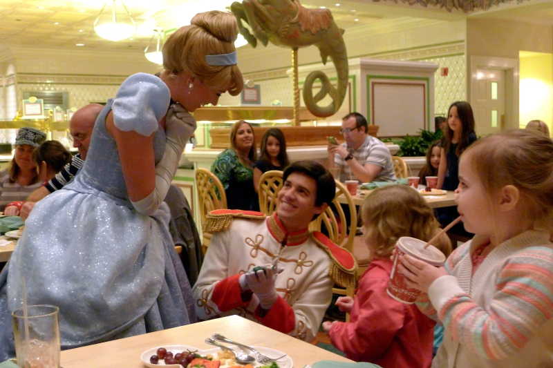 Prince Charming presenting Cinderella with Ava's rubber lizard at 1900 Park Fare