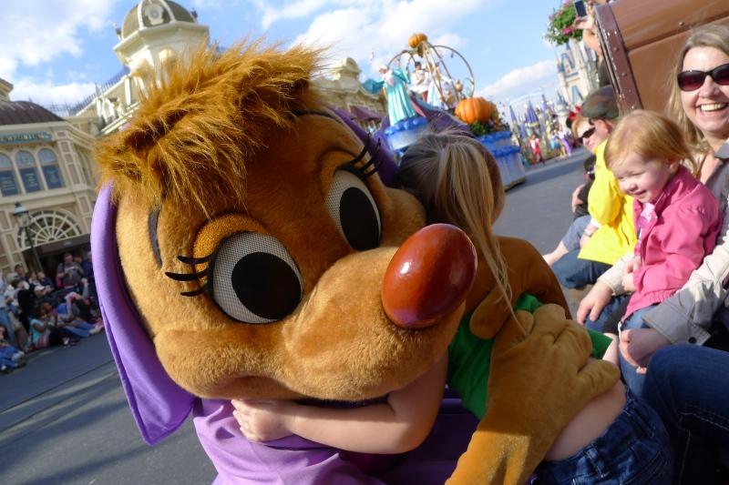 Raegan getting a big hug from one of Cinderella's mice