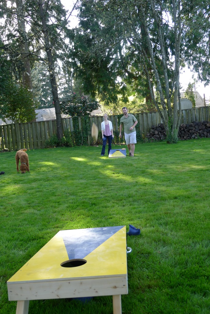 Jennifer and Stephen playing cornhole/bags in Genaro and Felicia's backyard