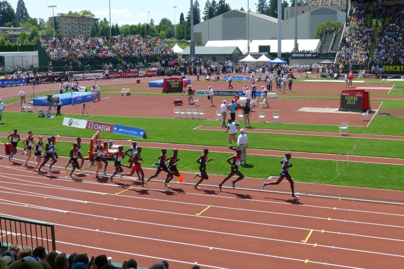 The men circle the track during the 5,000m race