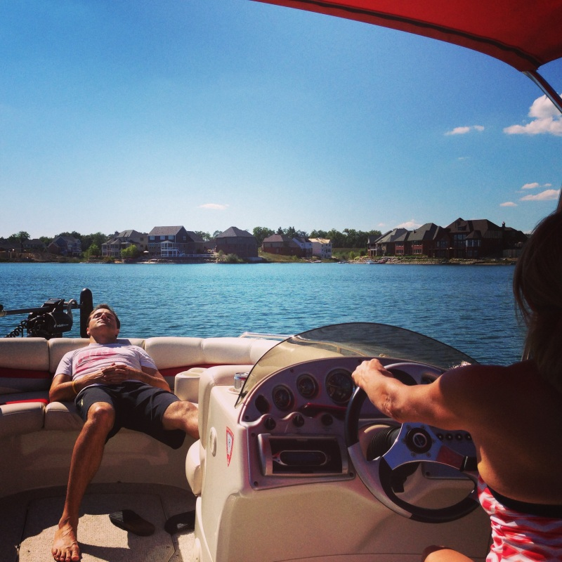 Relaxing on the Krasses' boat on their little lake