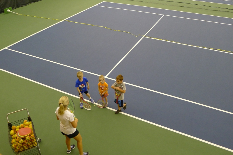 Ava at her tennis lesson at Midland Community Tennis Center