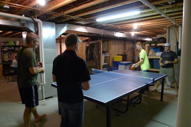 Dave, Jeff, Cory and Troy in a ping-pong battle