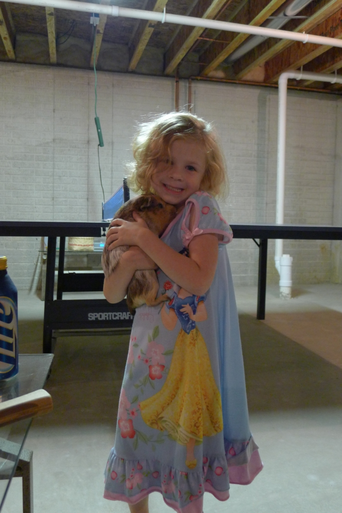 Ava with Clifford Neil Diamond, the monster guinea pig