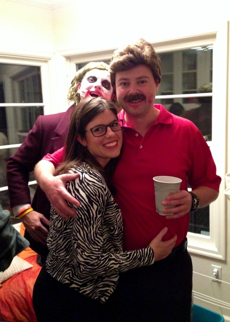 Leah and Todd (Tammy and Ron Swanson), with Jeff photobombing
