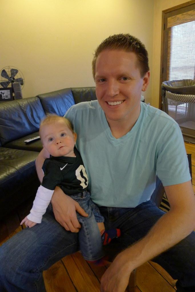 Little Spartan fan and his proud pops