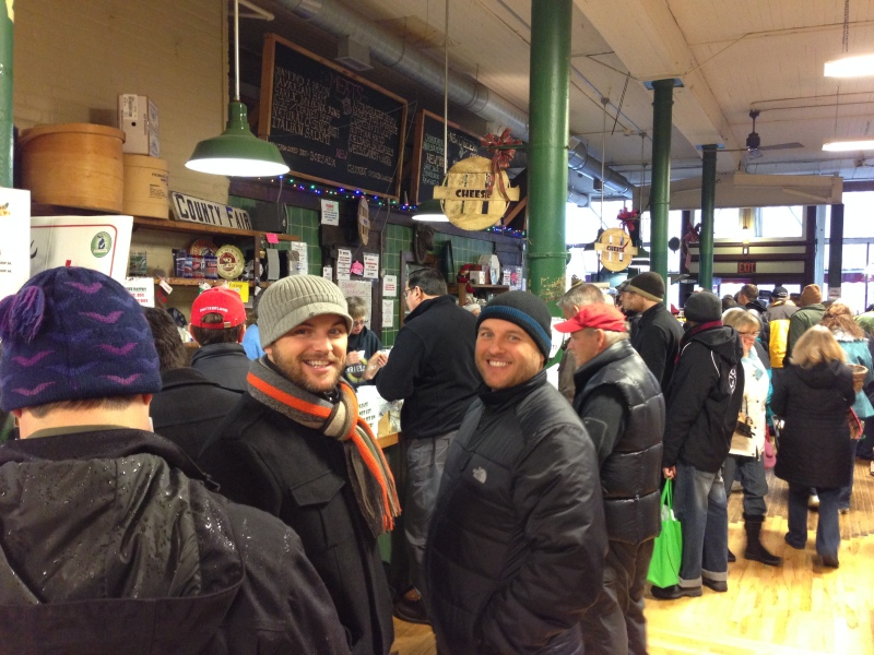 Brothers Jeff and Rob braving the crowds at Devries & Co. cheese store in Eastern Market
