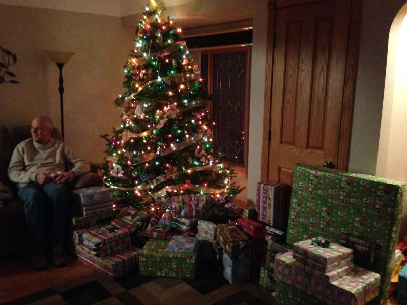 The family Christmas tree with the sea of presents for the 11 of us