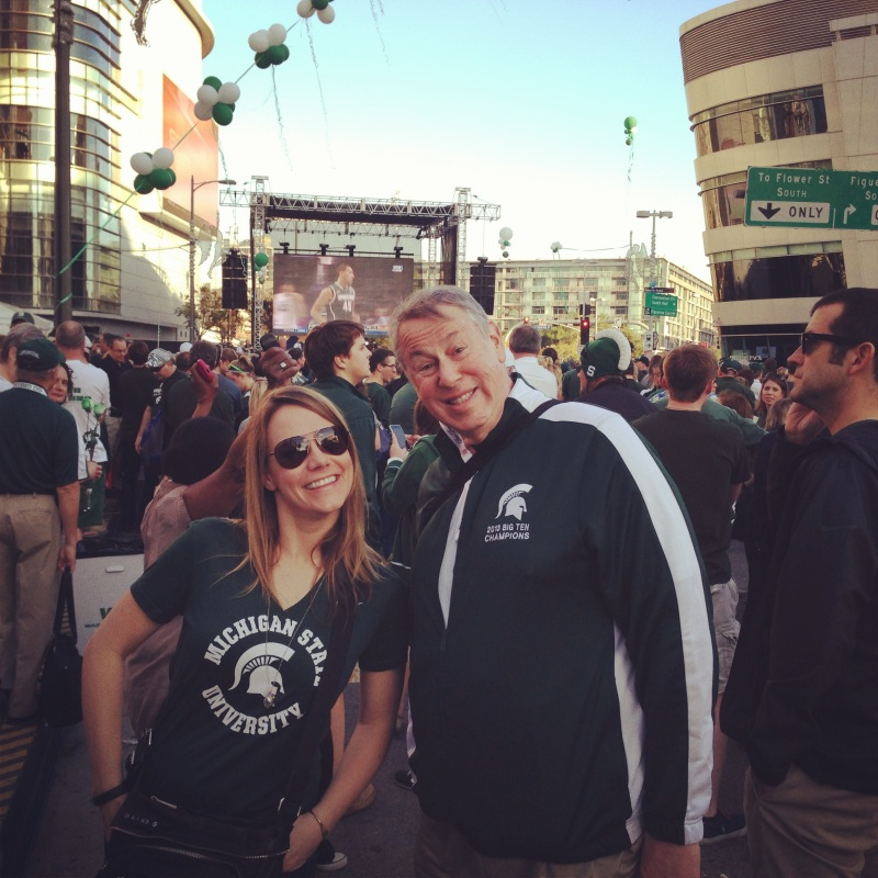 Getting peppy with a stranger at the Michigan State pep rally near the STAPLES Center