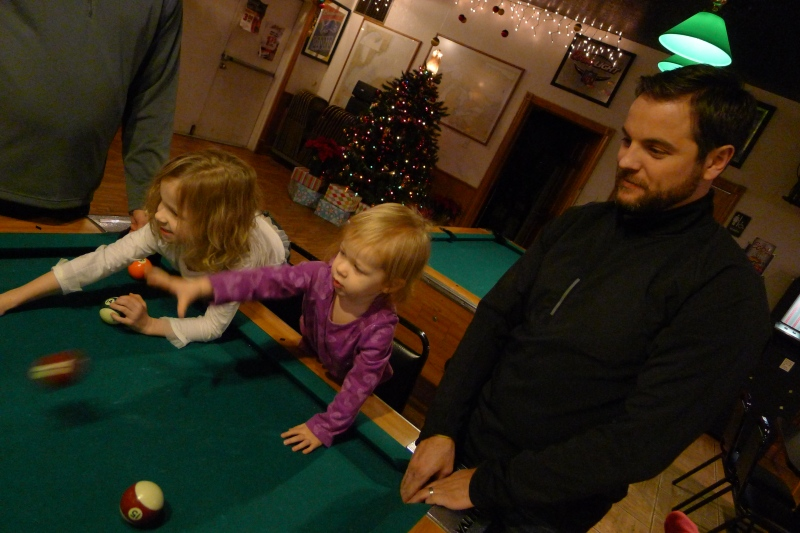 Uncle Jeff getting Ava and Macy started early with bar games