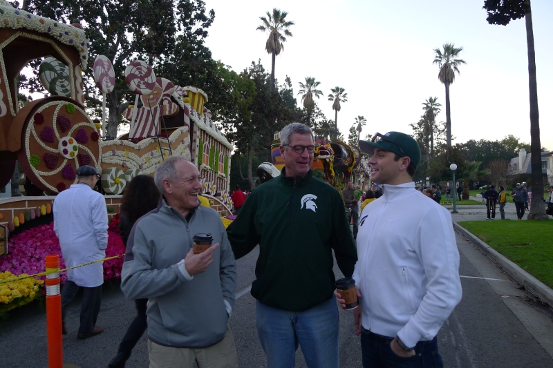 The guys enjoying the early-morning stroll along the floats