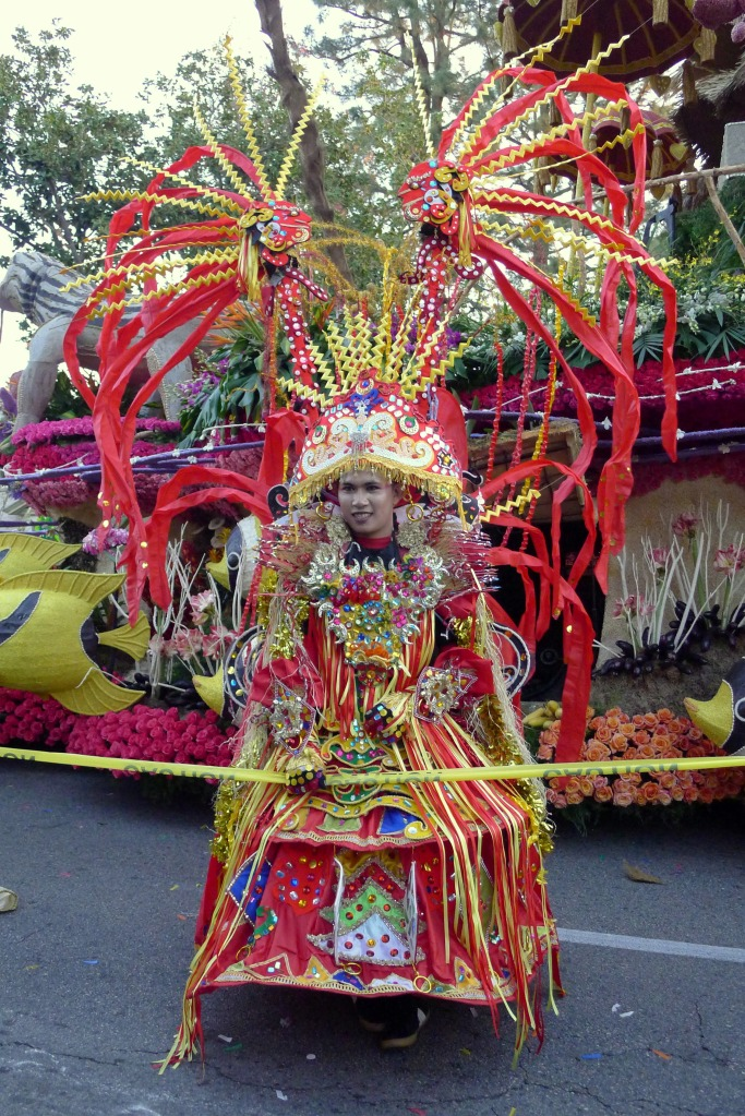 "One of the elaborate costumes accompanying the ""Wonderful Indonesia"" float"