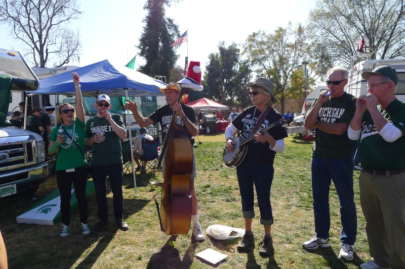 Jolly music-playing Michigan State fans