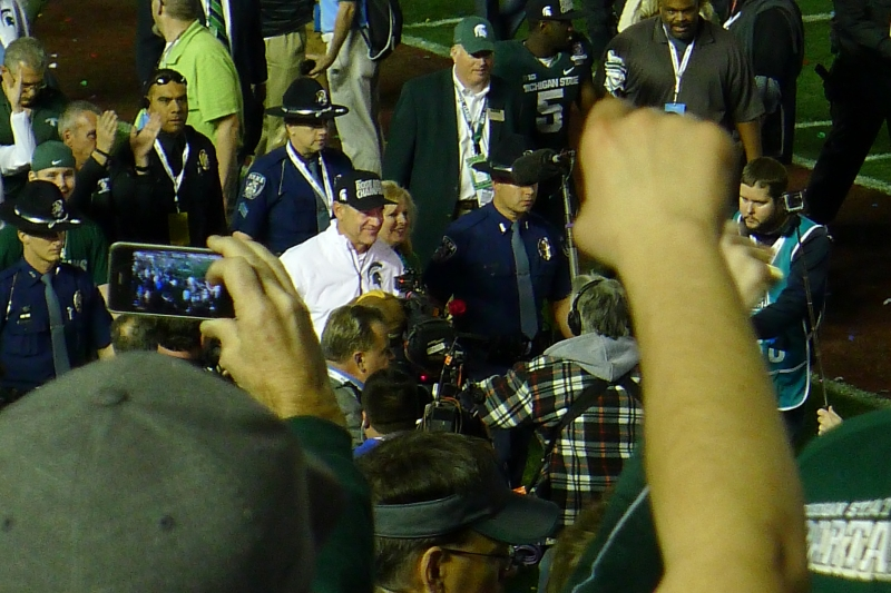 A proud Coach Dantonio walking to the tunnel