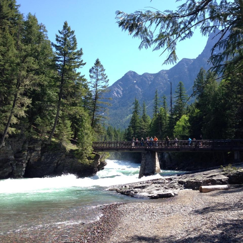 A footbridge crossing McDonald Creek in Glacier